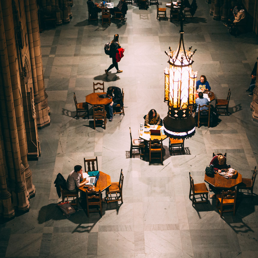 Students sitting in the Cathedral Commons